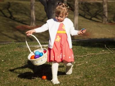 13131423 - little toddler girl on easter egg hunt in urban park.