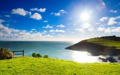 32488171 - irish landscape. coastline atlantic ocean coast scenery cloudy blue sky, church bay county cork, ireland europe